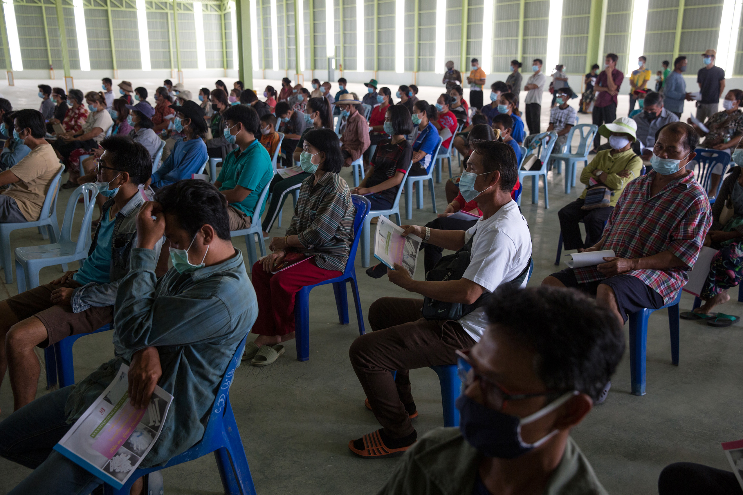 Local villagers from surrounding villages attend a meeting inside the industrial state that plans to become a recycling plant for plastics.