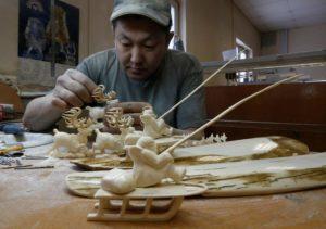 An entrepreneur carves figures from mammoth tusk in Yakutsk