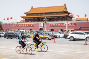 """Rental bikes in Beijing. """"We need research bodies and businesses to provide products and services which are both popular and good for the climate."""" (Image: Paul Quayle / Alamy)"""