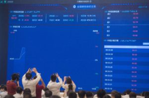 A screen in Wuhan shows data on China's national carbon market, on the day trading began