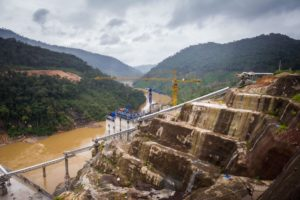 Construction site of the Nam Theun 1 hydropower project in Laos. New research has shed light on the various environmental and social risks posed by Chinese-funded overseas development projects (Image: Kaikeo / Alamy)