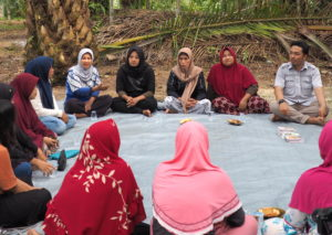 oil palm small holders sit in a circle